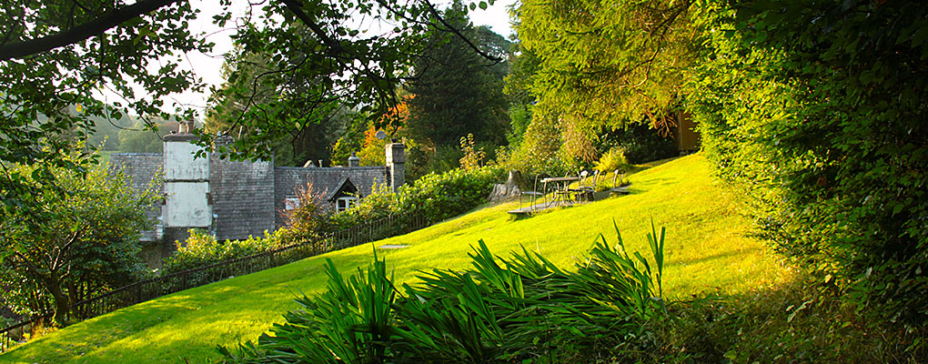 The Tarn House garden in September,  cottage in the background.