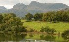 Loughrigg Tarn -The iconic Langdale Pikes behind. A five minute stroll from Tarn House.
